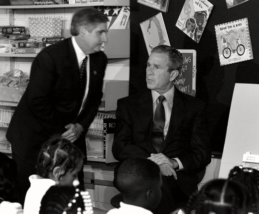 President George W. Bush and his Chief of Staff Andy Card, in the Sarasota, Florida, elementary-school classroom in which he learned America was under attack on the morning of 9/11. Members of the media who were covering Bush that day and who were with him in the classroom thought the stories and photos they'd be filing later would be about a new education-reform initiative. Not long after this photo was taken, however, they would shift their attention to another story, one that would consume many of them for days, weeks, or even months.